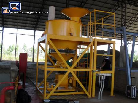 Mixer and doser for powdered products