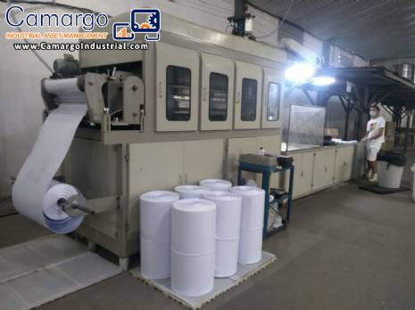 Automatic machine for manufacturing plastic cups